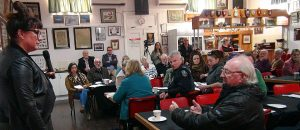 Goyder Business Breakfast - Peter Horne - Eudunda Family Heritage Gallery explains a point to Ali