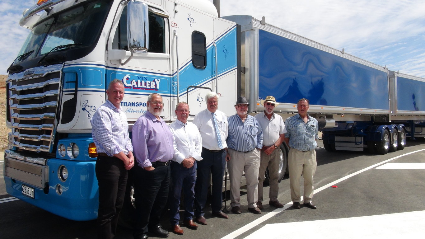 Officials in front of B-Double at Heavy Vehicle Bypass Opening
